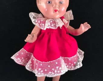Antique/Vintage Composition Girl Doll with Red Dress