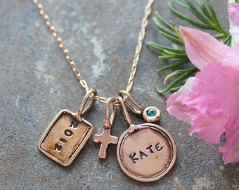 Rose Gold Necklace with stamped initial charms.  Trinket Initial Necklace with stamped charms in Rose Gold.  Initial Necklace in Rose Gold.