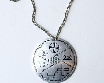 1940s aluminum pendant necklace / 40s vintage long silver medallion with Native symbols