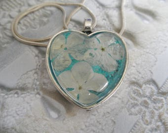 Snowball Bush Blossoms Pressed Flower Heart Pendant Atop Glowing Caribbean Ocean Blue Green-Symbolizes Thoughts Of Heaven-Nature's Art