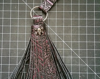 Purple and Black Handmade Embossed Filigree Leather Tassel with Metallic Gunmetal Jolly Roger Skull & Crossbones Keyring
