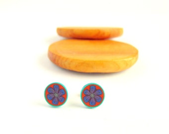Small Purple Flower Stud Earrings On Orange Background with Turquoise Blue Border, Polymer Clay, Stainless Steel. By Supremily Jewellery.