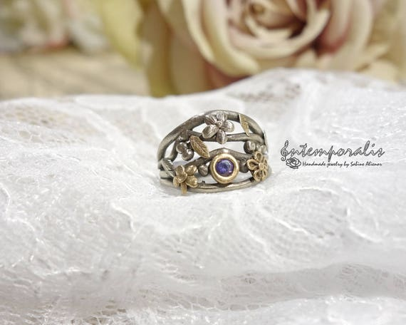 White bronze, silver color, ring decorated with gold bronze flowers and leaves and purlpe cubic zirconium, french size 54, OOAK, SABA12