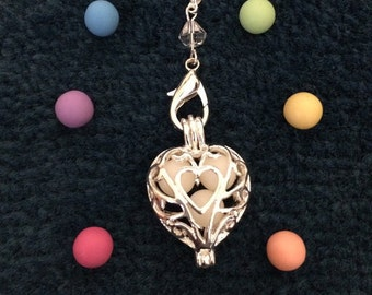 Silver plated Heart Filigree Diffuser Locket with 3 Aroma beads.