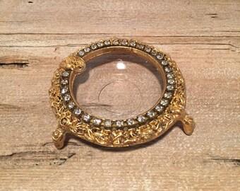 Celeste gold colored ashtry with diamond rhinestones. Hollywood regency ashtray.