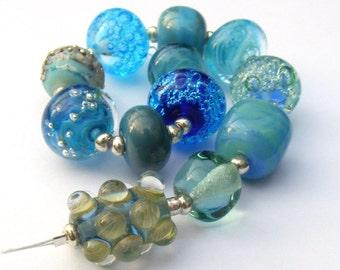 Handmade lampwork glass bead set of 12 aqua renegade beads - lampwork orphan beads
