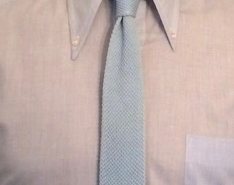 Vintage MENS Johnny Carson light blue cotton knit skinny tie with squared ends, made in Italy