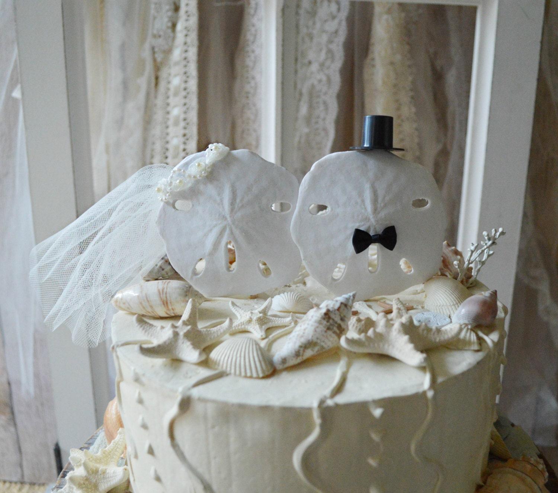 Sand dollar beach themed wedding cake topper bride and groom