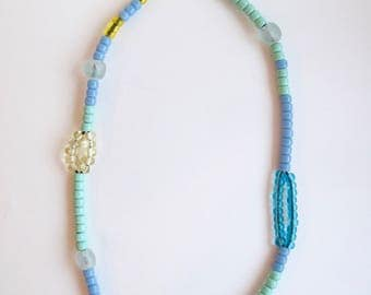 Long beaded necklace blue, mint green, translucent blue, yellow, and clear glass beads handmade lamp work yellow glass beads on leather cord