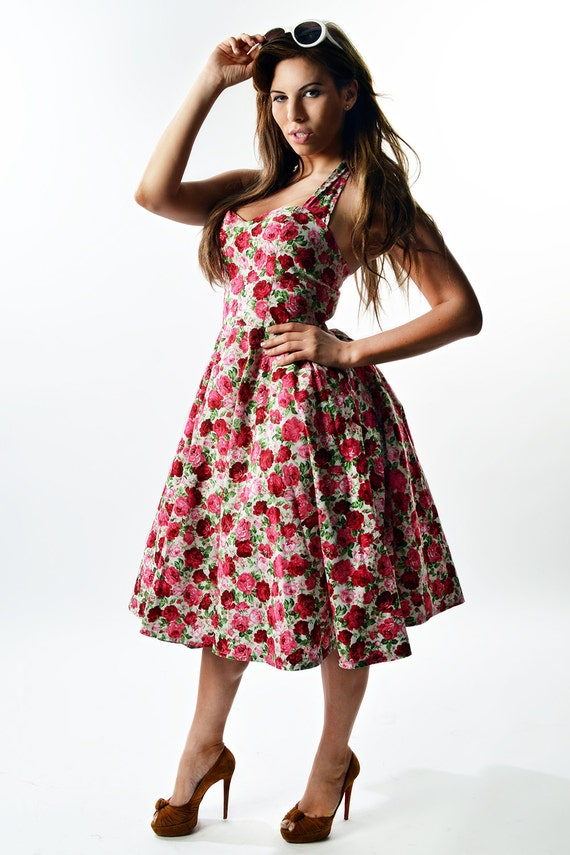 50's rockabilly dress with halter straps. Pink and white floral.