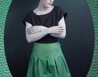 Mandrake in green and gold fabric skirt