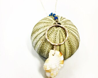 Kauai triton shell necklace featuring a hammered hoop & teal rosary on a 14k gf cable chain