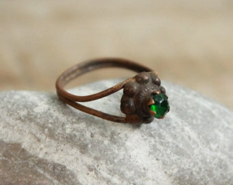 antique ring ... jewelry rusty ring ... with a green stone ... from archaeological dig ...  found object ... archaeological finds