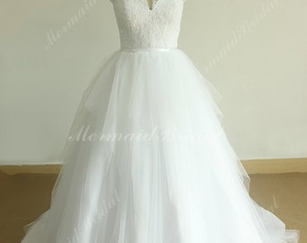 Romantic white A line tulle vintage lace wedding dress with sweetheart neckline and assymetric ruffles