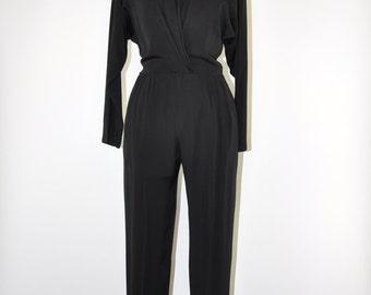 70s black wrap jumpsuit / 1970s rayon playsuit / black minimalist jumpsuit