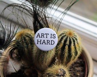 Art is Hard 32mm pin back badge