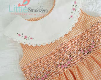 Beautiful peach checked hand smocked dress with embroiderey