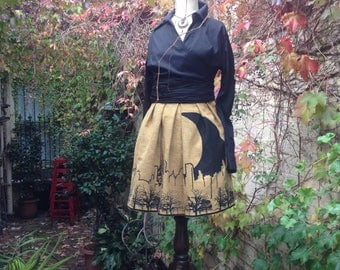 A lovely yellow designer pleated skirt with screen print of Melbourne sky line on vintage fabric