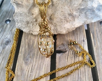 Hand Beaded Gold Crystal Ball Caged Pendant 2.25 Inches Long .75 Inches Wide on 27.5 Inch Long Gold Rope Chain, One of a Kind