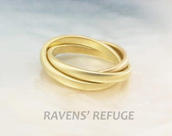 handmade 18k gold rolling rings / interlocking bands / Russian wedding ring