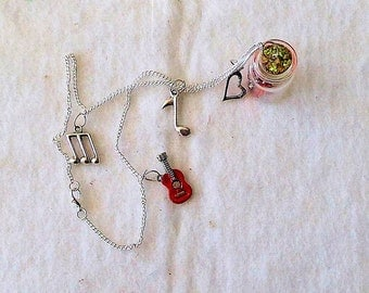 Necklace with pendant, charms, glass bottle, I love music