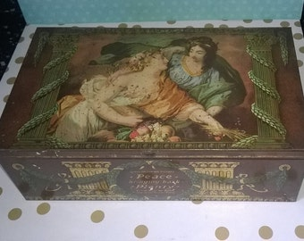 Vintage Squirrel Confectionery tin with 'Peace bringing back Plenty' classical painting