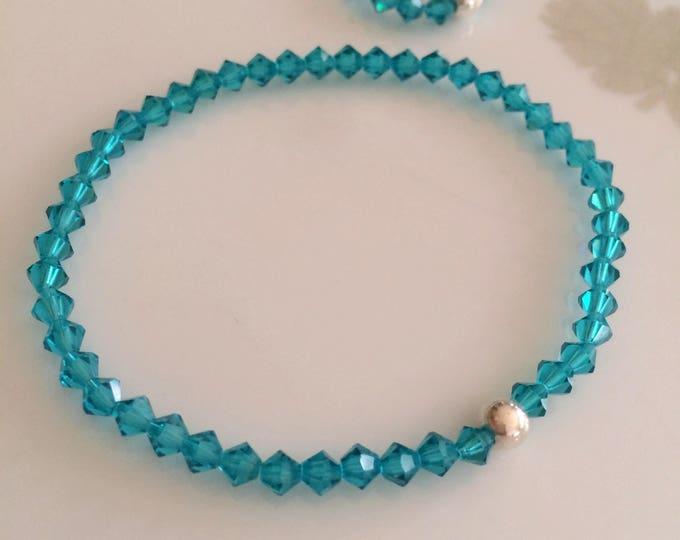 Blue Zircon Swarovski crystal stretch bracelet with Sterling Silver or 14K Gold Fill bead
