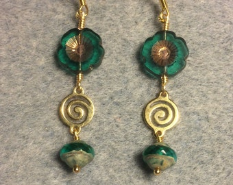 Translucent teal and gold Czech glass pansy bead dangle earrings adorned with gold swirly connectors and teal Czech glass Saturn beads.
