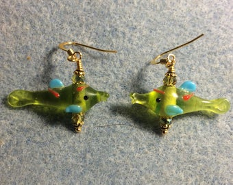 Translucent olive green and turquoise lampwork fish bead earrings adorned with olive green Chinese crystal beads.