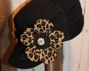Cheetah print flower pin clip.  Hat or hair accessory black and tan