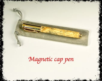 Rollerball pen with a magnetic cap.