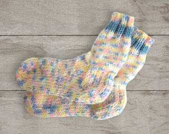 Vintage knitted socks. Hand knitted socks. Unused knitted socks. Winter socks. Pink, blue, white and yellow knitted socks. Women socks.