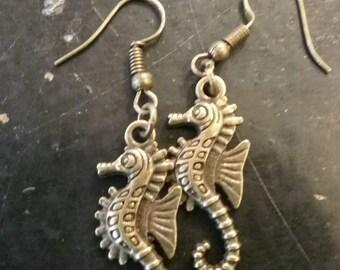Bronze plated seahorse hook earrings.