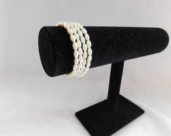 Four Elegant Cream Pearl Bracelets