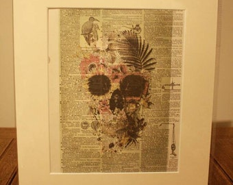 """Ideal gift, Dictionary art print floral skull printed on 1907 dictionary sheet in a 12"""" x 14"""" cream mount."""