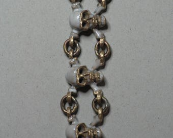 bronze skull and white enamel bracelet