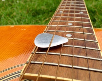 Pure silver // Guitar pick, plectrum // Handmade in UK // Can be supplied with hole and jump ring for necklace