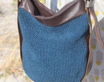 Up cycled knit and leather, upcycled belts, hand made shoulder bag.
