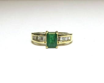 emerald engagement ring two carats with enhancing baguette diamonds in 14k yellow gold