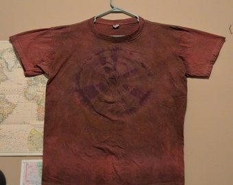 red, brown, and purple tie-dyed t-shirt