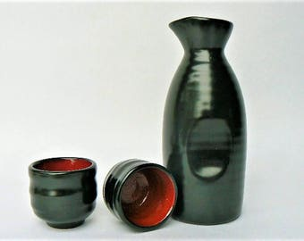 "Black Sake Ceramic Pitcher and 2 Cup Set - Red Interior Stoneware Saki Rice Wine Containers - Ribbed Texture - Pitcher 6.5"" Tall, Cups 2""x2"""