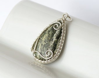 sterling silver wire wrap pendant with natural swiss opal cabochon