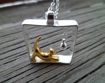"Silver Necklace with a Pendant ""Cat Playing with a Ball"". Sterling Silver 925 with 14k gold plated gilding ."