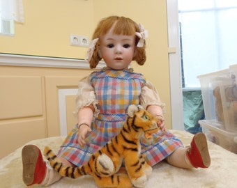 Antique doll adorable character doll with cute vintage doll dress