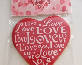 six stenciled valentine's cookies