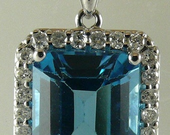Blue Topaz 6.19ct Pendant with Diamonds 0.37ct 18k White Gold