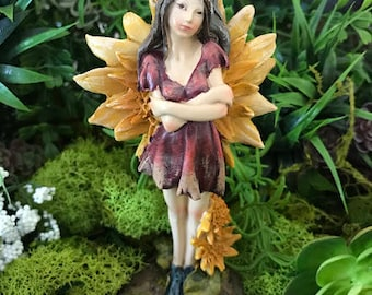 Miniature Forest Fairy with Yellow Flower Wings and Ladybug