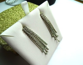 Clear prong set rhinestone waterfall earrings .Exceptional sparkle. Tiny clear rhinestones fall in a beautiful waterfall.