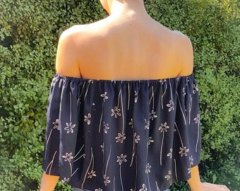 Women's strapless off the shoulder navy top size 6 -10 AU navy white floral flowy sleeves