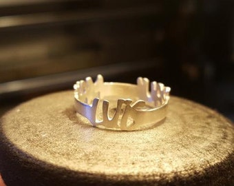 Ring with two names